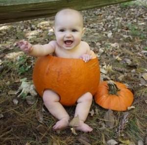 baby wearing a compostable pumpkin diaper