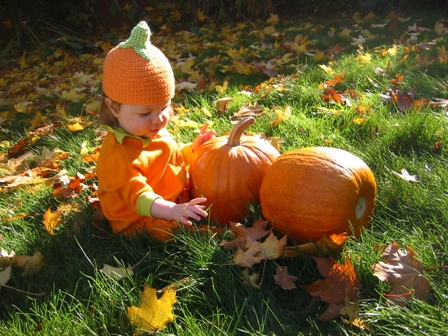 baby with organic pumpkins