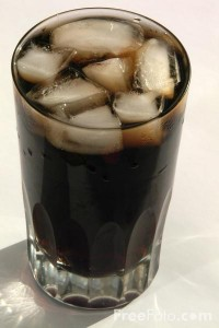 soft drink in glass with ice