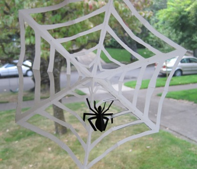 unfold the web hang it on the window stick the spider on it and shiver in fright
